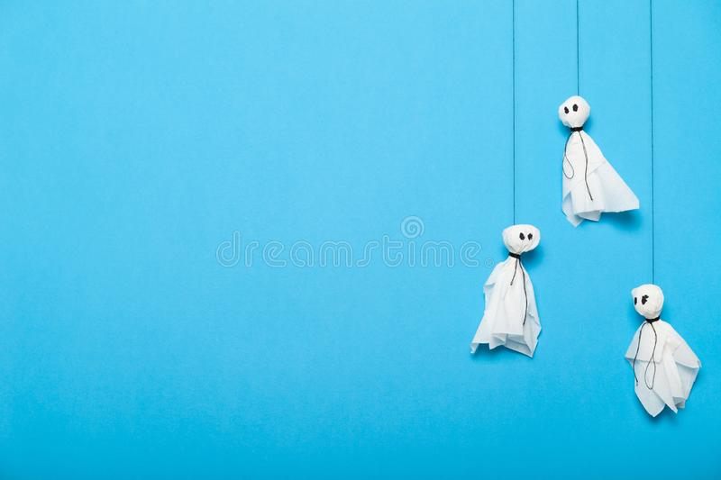 Kids paper ghosts artwork. Autumn halloween celebrating. Copy space for text royalty free stock images