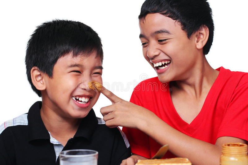 Kids and Peanut butter royalty free stock image