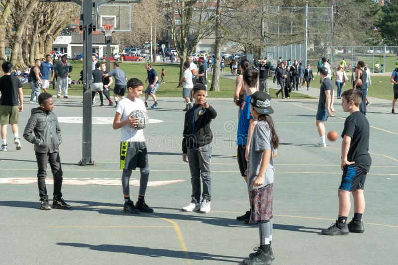 Kids picking teams. Seattle, Washington - 2019-03-17 - Kids picking teams for basketball in Greenlake as Spring begins in Seattle royalty free stock image
