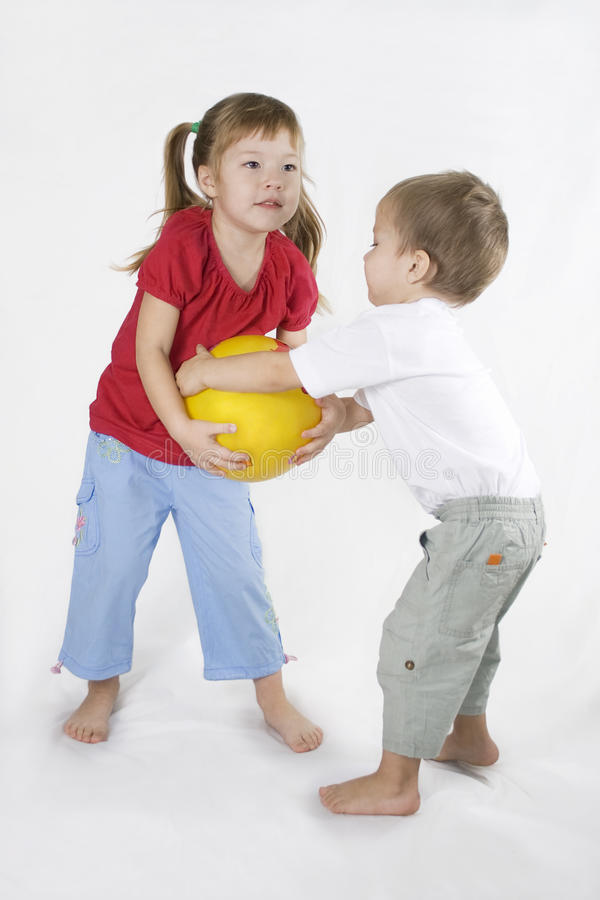 Free Kids Play Ball. Conflict Situation. Stock Photography - 12677372