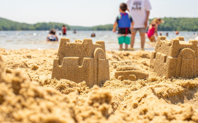 Kids play on beach with sand stock photography