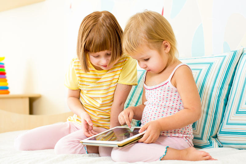 Kids play with digital tablet royalty free stock photo