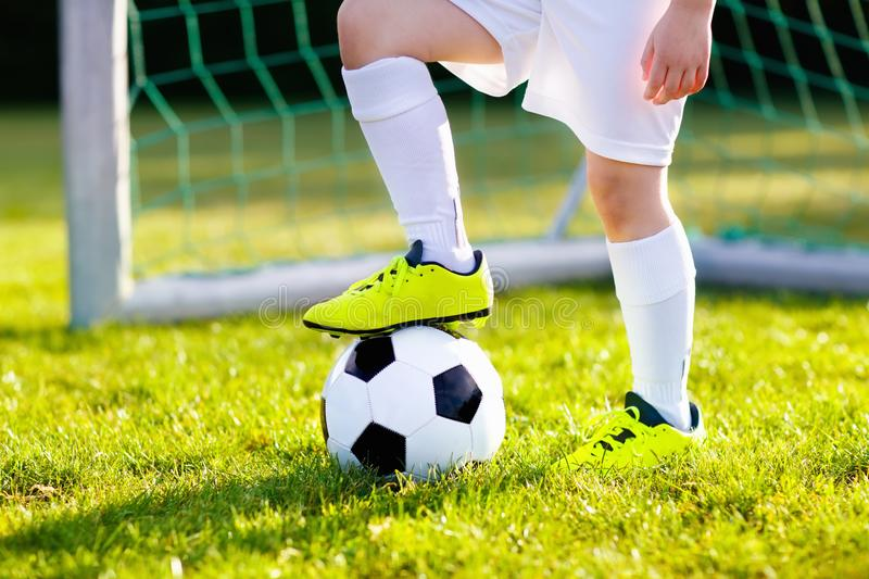 Kids play football. Child at soccer field. stock photo