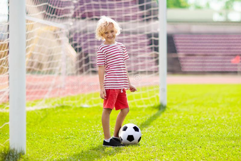 Kids play football. Child at soccer field royalty free stock photography