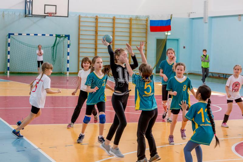 Kids play handball indoor. Sports and physical activity. Training and sports for children. Russia, Vladivostok, 04/28/2018. Kids play handball indoor. Sports and royalty free stock image