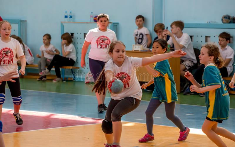 Kids play handball indoor. Sports and physical activity. Training and sports for children. Russia, Vladivostok, 04/28/2018. Kids play handball indoor. Sports and stock image