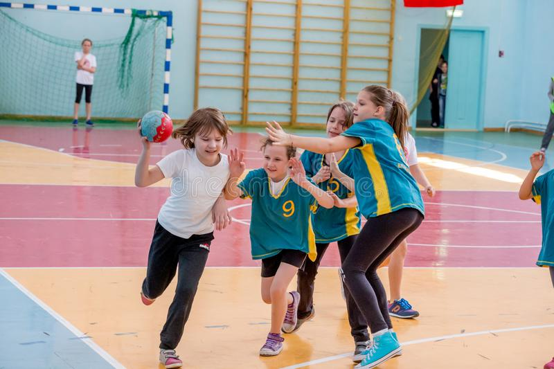 Kids play handball indoor. Sports and physical activity. Training and sports for children. Russia, Vladivostok, 04/28/2018. Kids play handball indoor. Sports and stock images