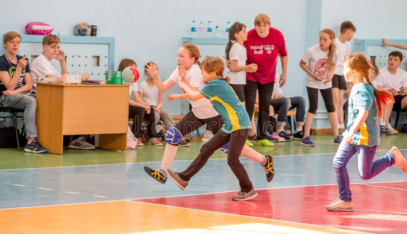 Kids play handball indoor. Sports and physical activity. Training and sports for children. Russia, Vladivostok, 04/28/2018. Kids play handball indoor. Sports and stock photo