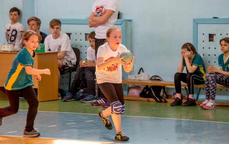 Kids play handball indoor. Sports and physical activity. Training and sports for children. Russia, Vladivostok, 04/28/2018. Kids play handball indoor. Sports and stock photos