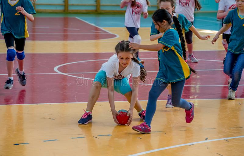 Kids play handball indoor. Sports and physical activity. Training and sports for children. Russia, Vladivostok, 04/28/2018. Kids play handball indoor. Sports and stock photography