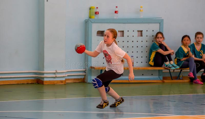 Kids play handball indoor. Sports and physical activity. Training and sports for children. Russia, Vladivostok, 04/28/2018. Kids play handball indoor. Sports and royalty free stock photos