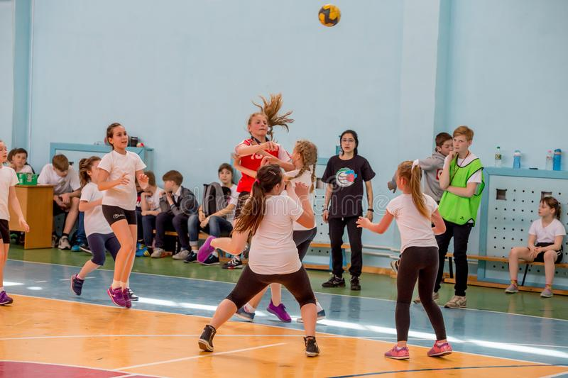 Kids play handball indoor. Sports and physical activity. Training and sports for children. Russia, Vladivostok, 04/28/2018. Kids play handball indoor. Sports and royalty free stock photography