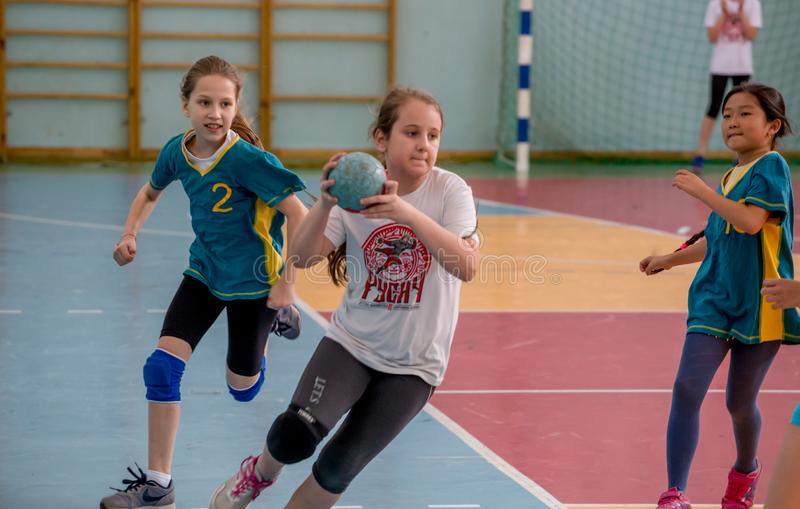 Kids play handball indoor. Sports and physical activity. Training and sports for children. Russia, Vladivostok, 04/28/2018. Kids play handball indoor. Sports and royalty free stock photo