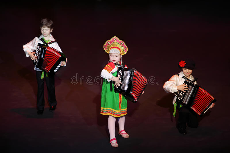 Kids play music at concert. MOSCOW - MARCH 17: Kids play music at concert of Gennady Ledyakh School of Classical Dance in theater Et Cetera, on March 17, 2011 in royalty free stock photography