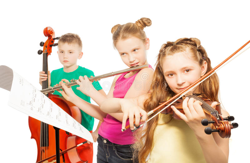 Kids play musical instruments on white background. Kids playing on musical instruments together on white background stock image