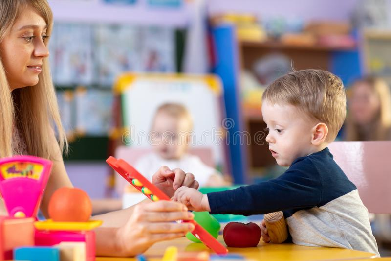Kids play role game in toy shop at nursery or kindergarten royalty free stock photo