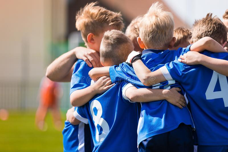 Kids Play Sports. Children Sports Team United Ready to Play Game. Children Team Sport. Youth Sports For Children. Boys in Sports Uniforms. Young Boys in Soccer royalty free stock photo