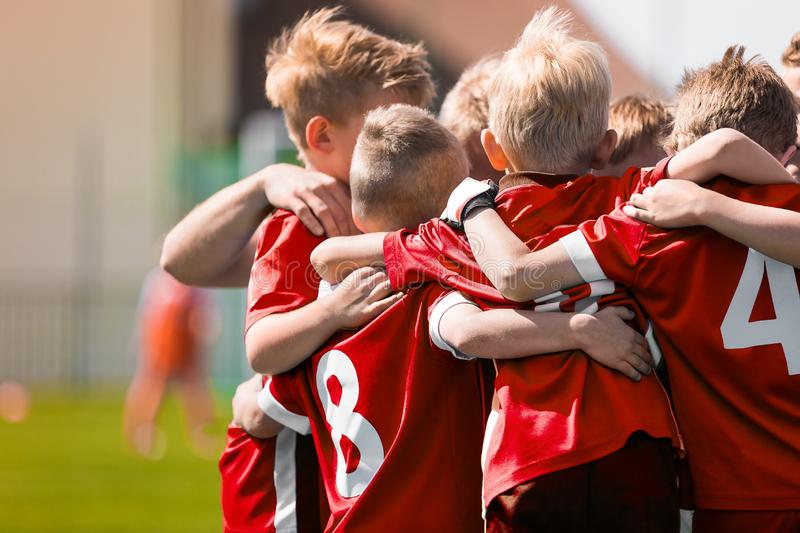 Kids Play Sports Game. Children Sporty Team United Ready to Play Game. Children Team Sport. Youth Sports For Children. Boys in Sports Jersey Red Shirts. Young royalty free stock photos