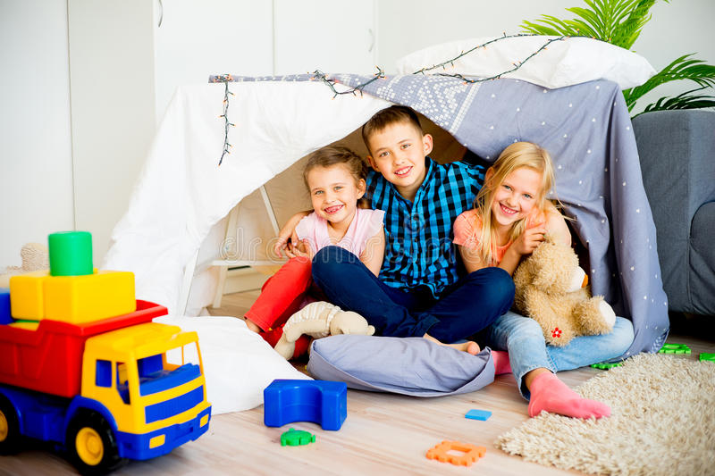 Kids in a play tent royalty free stock photo