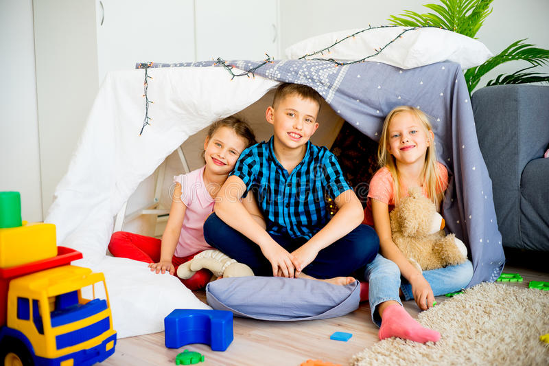 Kids in a play tent stock photos