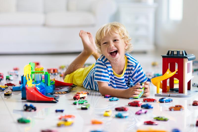 Kids play with toy cars. Children playing car toys royalty free stock photo