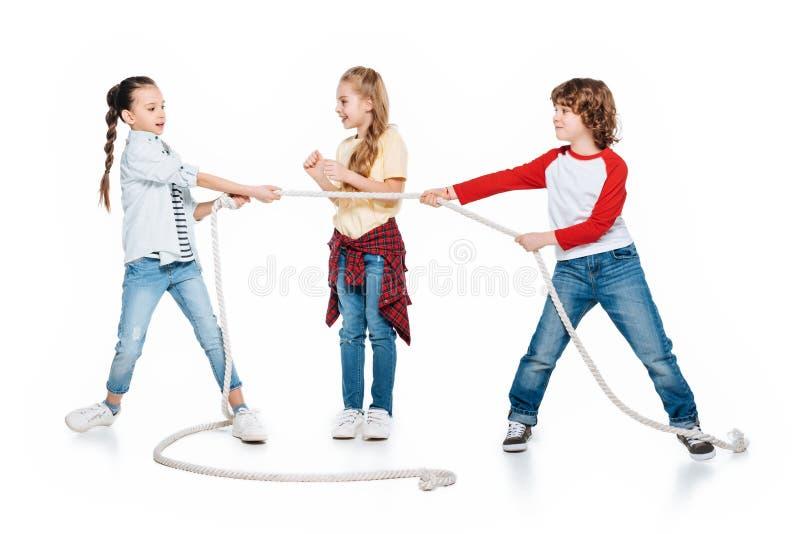 Kids play tug of war stock photography