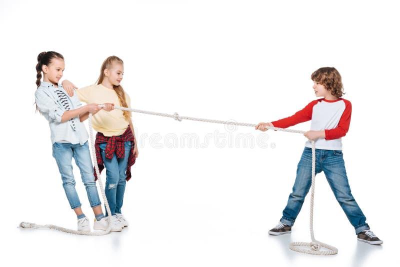 Kids play tug of war stock image