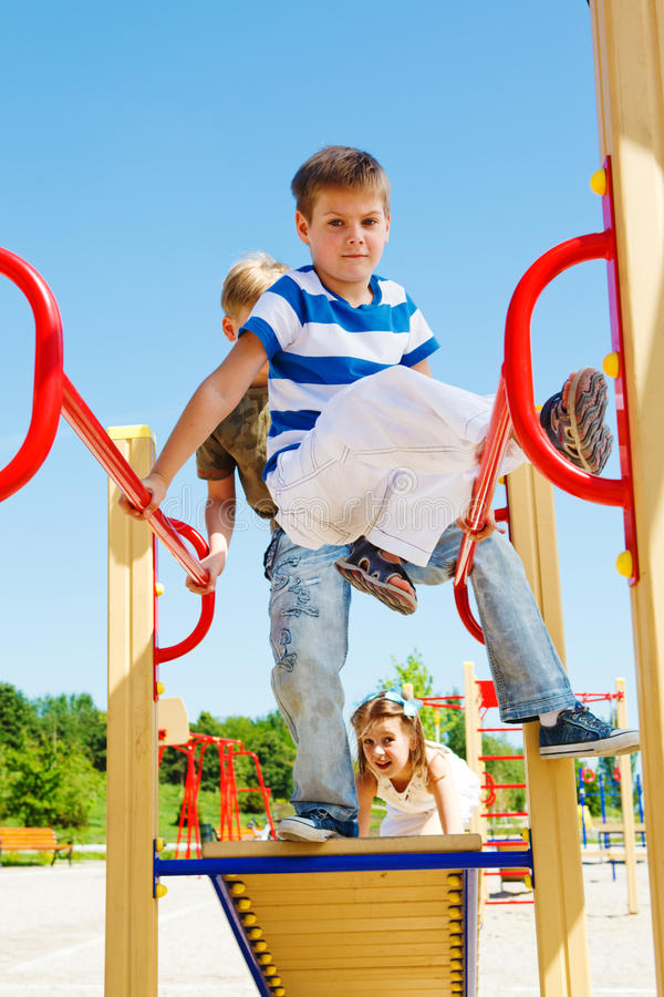 Kids on the playground. Kids having fun on the playground royalty free stock image
