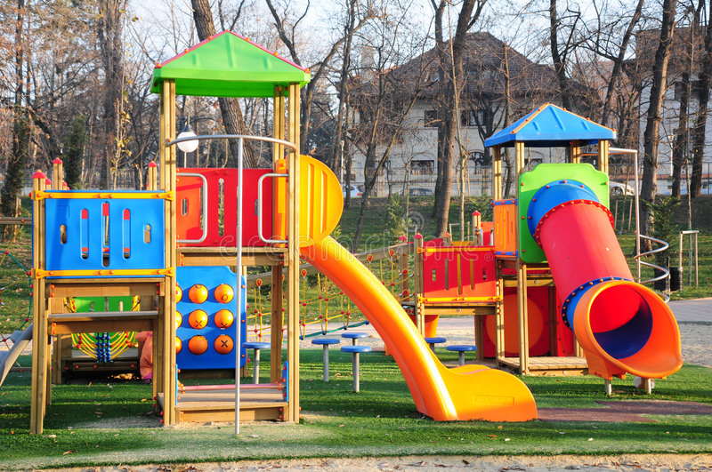 Kids playground. A colorful kids playground with various slides in a park royalty free stock photography