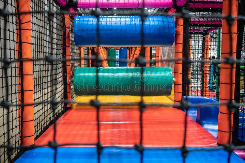 Kids playground for gym with slide and maze in kindergarten. Mod stock photo