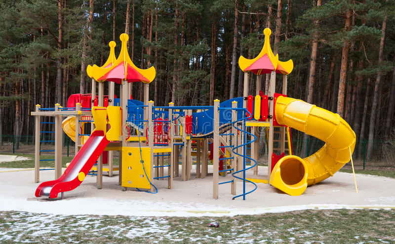 Kids playground. Site with various equipment in winter royalty free stock image