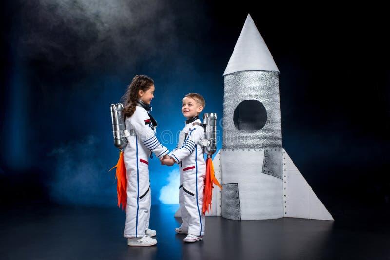 Kids playing astronauts royalty free stock image