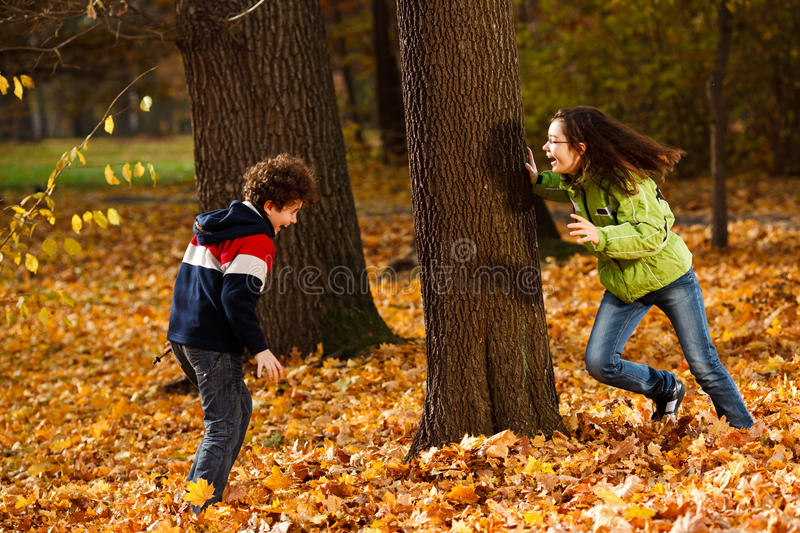 Download Kids Playing In Autumn Park Stock Photo - Image: 23097386