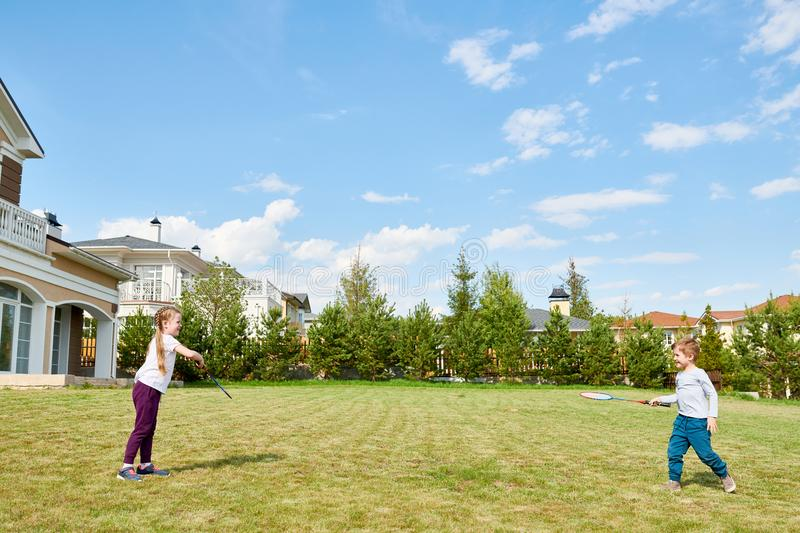 Kids Playing Badminton in Front Yard royalty free stock photography