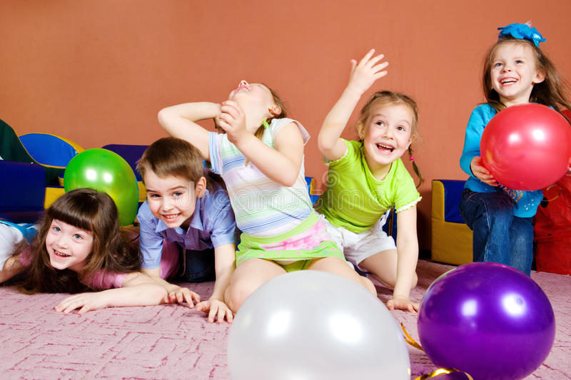 Download Kids playing with balloons stock image. Image of girl - 15200523