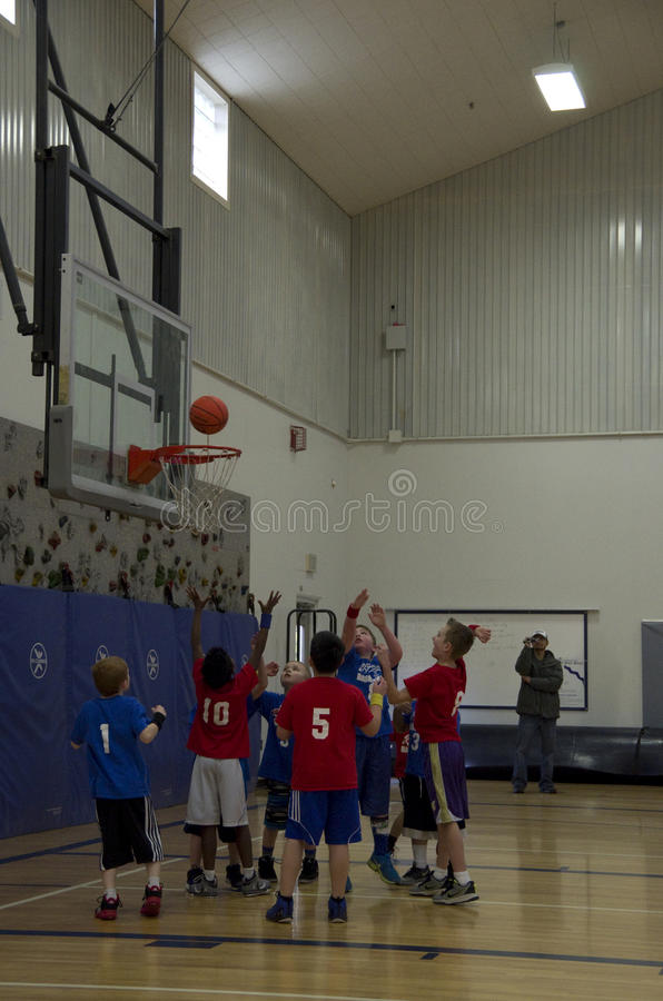 Kids playing basketball match stock images