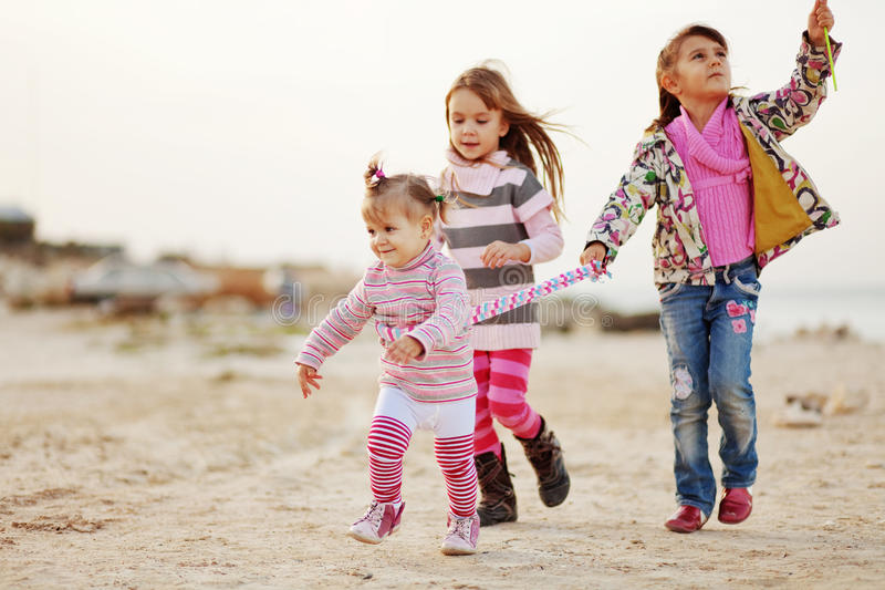 Download Kids playing at the beach stock photo. Image of group - 21162690