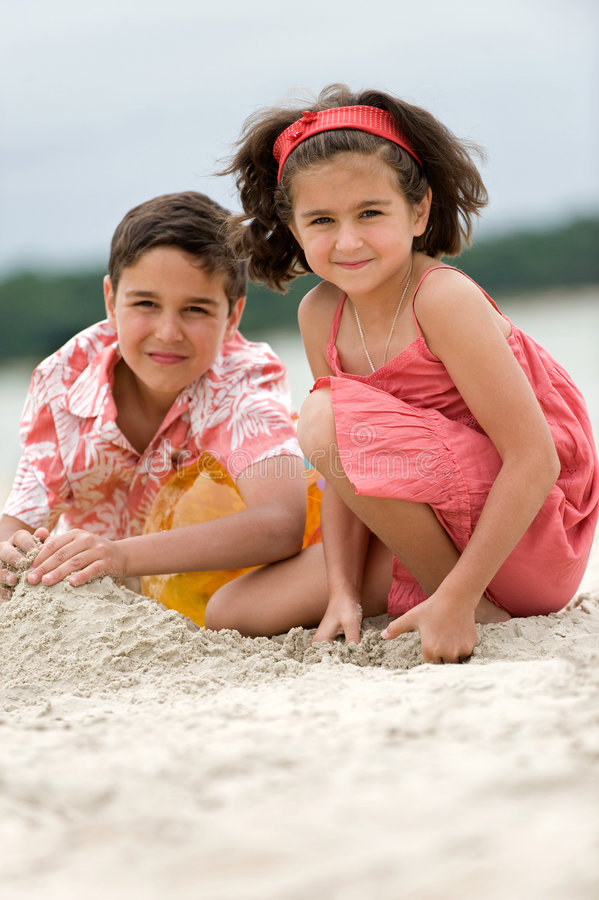 Kids playing on the beach royalty free stock photo