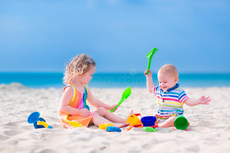 Beach Toys For Girls : Kids playing on the beach stock image of exotic