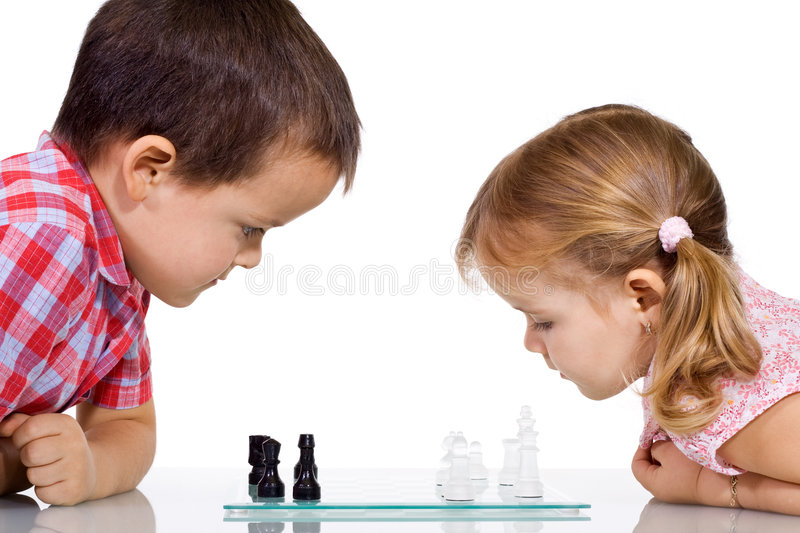 Kids playing chess royalty free stock photo