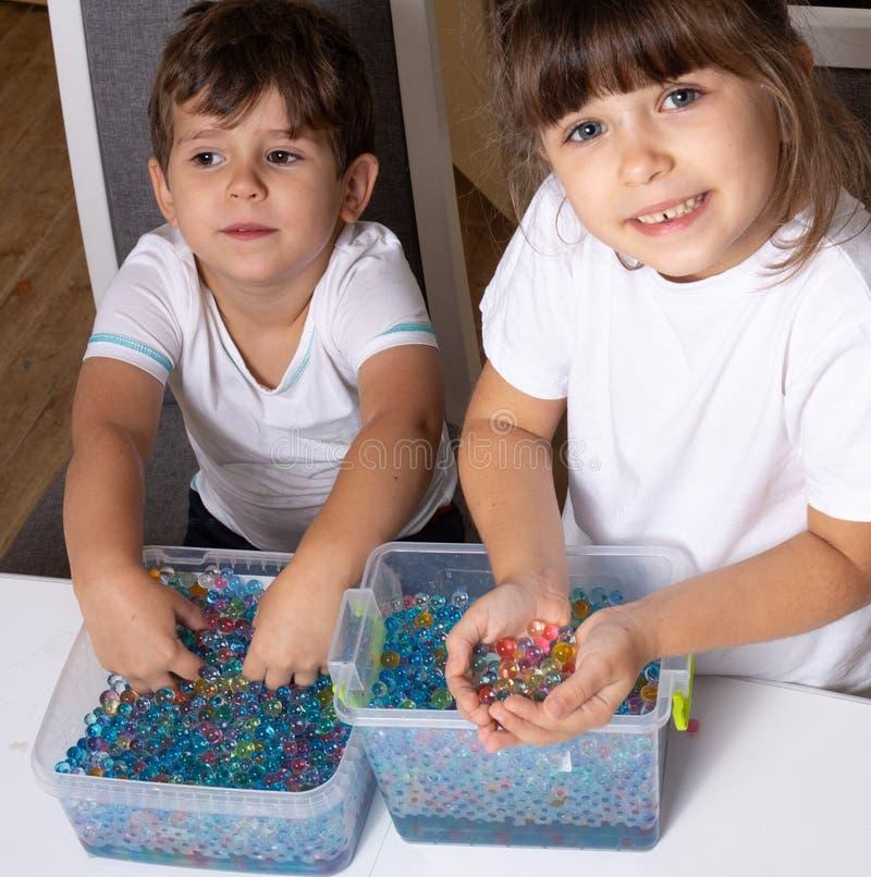 Kid playing orbeez. Orbeez balls - sensory water beads. stock photography