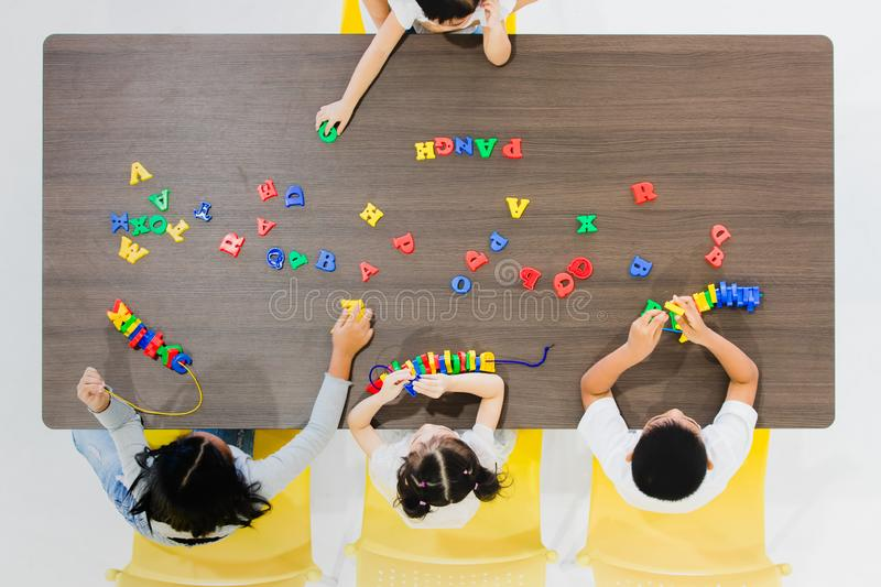 Kids playing colorful toys royalty free stock photography
