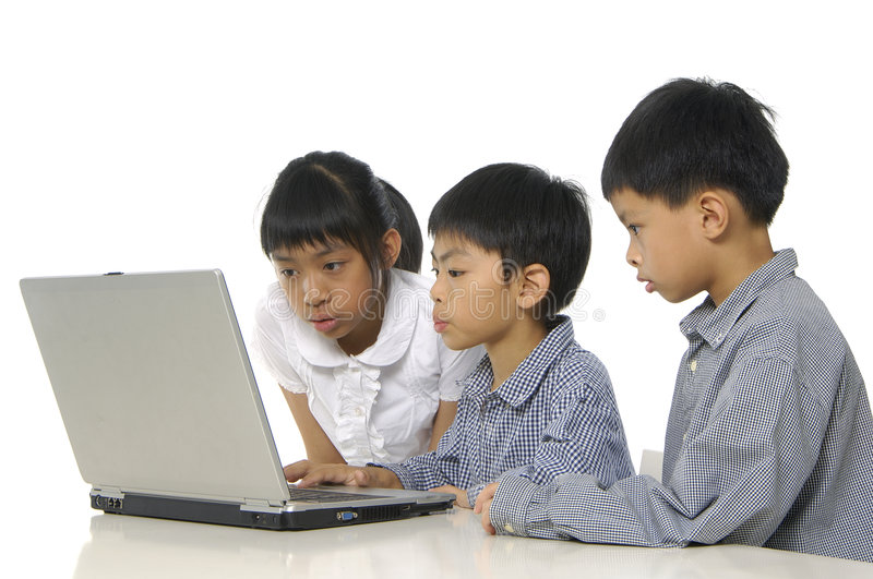 Kids playing computer royalty free stock image