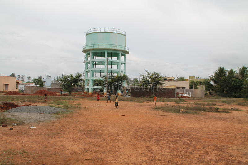 Kids Playing cricket near Watertank royalty free stock images