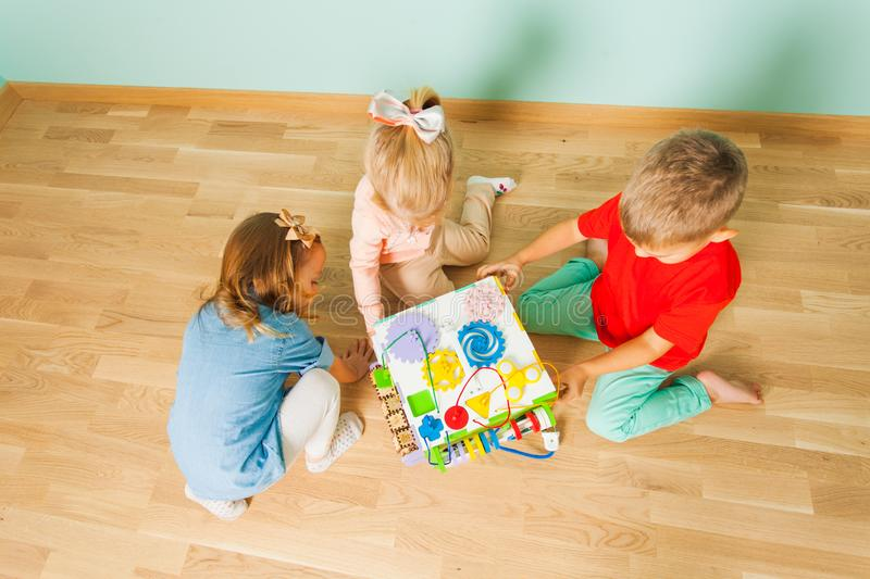 Kids playing at day care. Top view stock photo