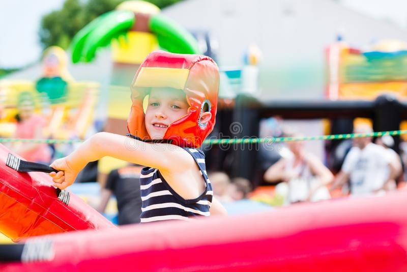 Kids playing - fighting. In colorful playground stock images