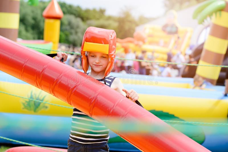 Kids playing - fighting. In colorful playground stock photography