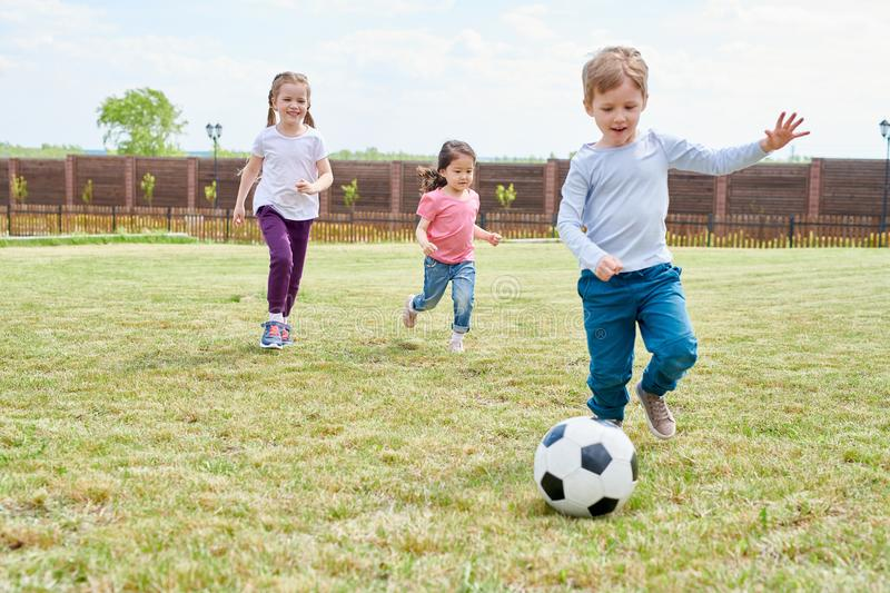 Kids Playing Football stock images