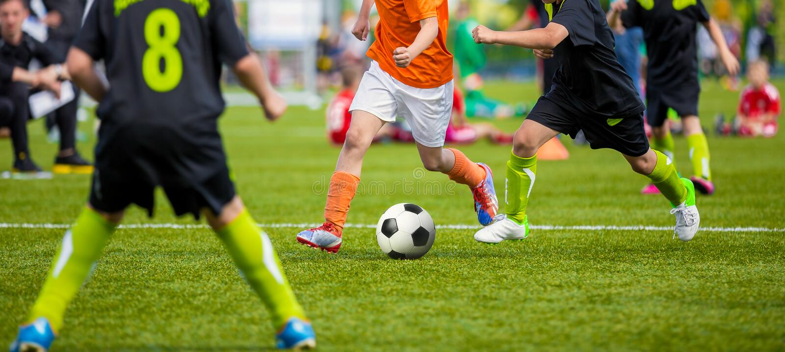 Kids Playing Football Soccer Game on Sports Field. Boys Play Soccer Match on Green Grass. Youth Soccer Tournament Teams Competitio stock images