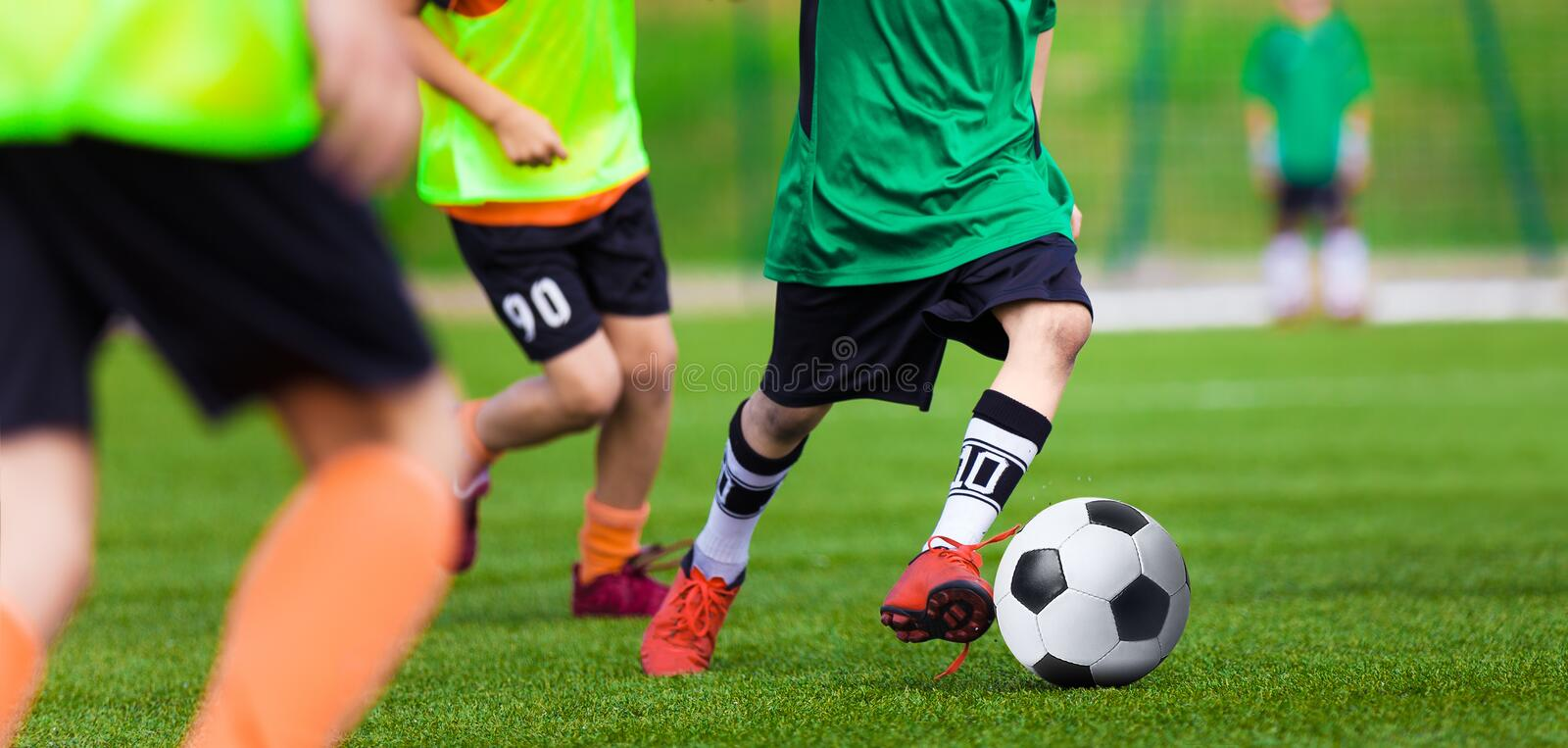 Kids Playing Football Soccer Game on Sports Field. Boys Play Soccer Match. On Green Grass. Youth Soccer Tournament Teams Competition. Running Youth Football royalty free stock photos